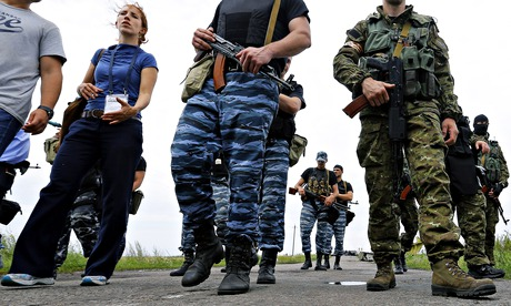 The MH17 crash site is controlled by armed pro-Russia militia, who are carefully supervising access to journalists and investigators. Photograph: Robert Ghement/EPA