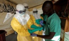 Health specialists work in an isolation ward for ebola patients at a Doctors Without Borders facility in southern Guinea.