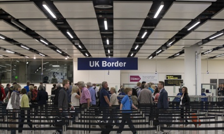 Border Force check the passports of passengers arriving at Gatwick Airport.