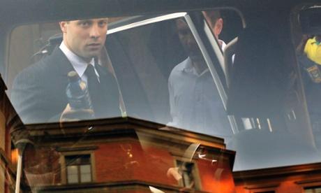 Seen through a car window, Oscar Pistorius leaves the court today.