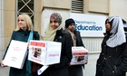 Fahma Mohamed and fellow campaigners gather before their meeting with Michael Gove