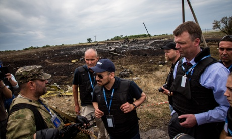 Alexander Hug - Deputy Chief Monitor of the OSCE special monitoring mission to Ukraine talks to Russia-backed separatist commander during a visit to MH17 flight crash site in the village of Grabovo, East Ukraine.