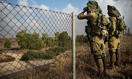 Israeli soldiers on a hill overlooking the Israeli-Gaza border