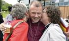 Bishop of Gloucester Michael Perham hugs female clergy members