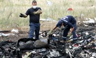 Rescuers work at the crash site of the Malaysia Airlines flight MH17