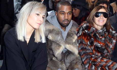 Noomi Rapace, Kanye West and Carine Roitfeld at the Givenchy Menswear show in 2014.