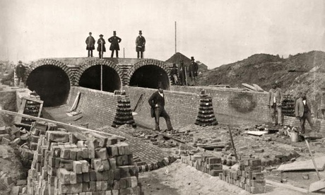 Sir Joseph William Bazalgette, top right, overlooks the Northern Outfall sewer being built below the Abbey Mills pumping station. Photograph: Getty Images