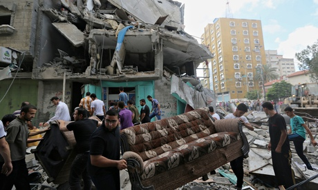 Palestinians salvage their usable belongings from the rubble of their homes