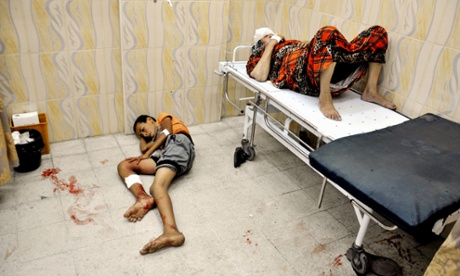 Palestinians sit at a hospital in the northern Gaza  Israel-Gaza conflict, Gaza Strip, Palestinian Territories - 24 Jul 2014.