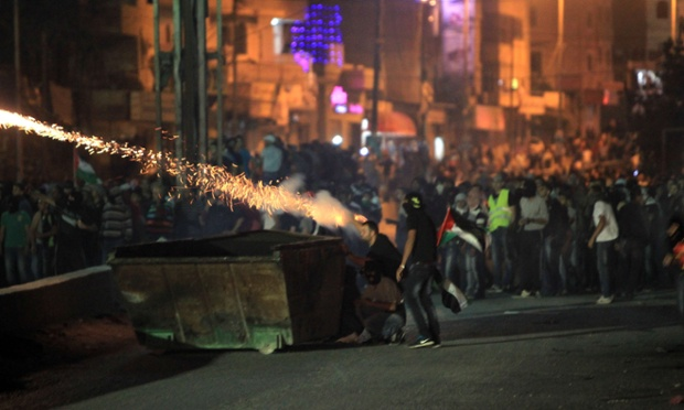 Palestinian protesters marching against Israel's offensive in Gaza clash with Israeli soldiers and border police at the Qalandiya checkpoint between Jerusalem and Ramallah.