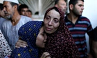 Palestinians mourn for their dead relatives at a hospital in Jabaliya, Gaza Strip