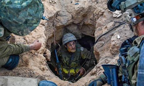 Israeli soldiers uncover a Palestinian tunnel in Gaza Strip