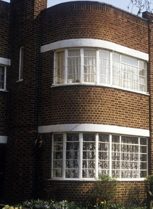 West London, UK detail of suntrap windows on 1930s semi detached suburban house