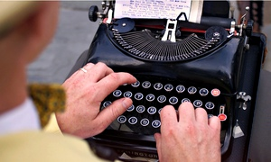 Man typing on old fashioned typewriter
