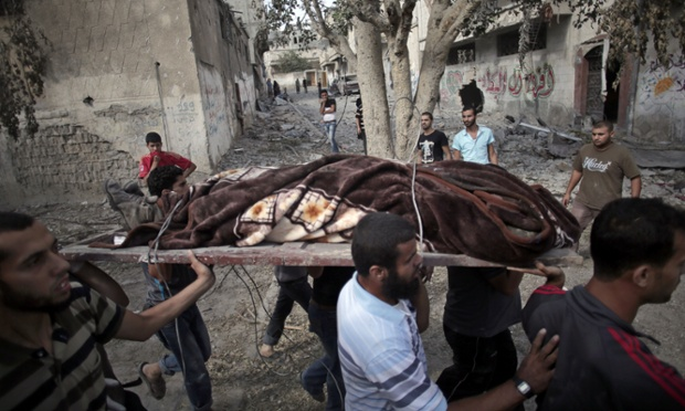 Palestinians carry a body of a man found under the rubble of a destroyed house during a 12-hour cease-fire in Gaza City's Shijaiyah neighbourhood.