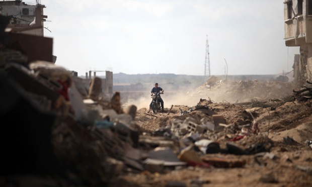 Palestinians inspect destroyed houses in the Shejaia neighbourhood of Gaza City.