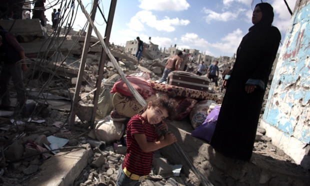 A Palestinian girl looks on as her family salvage belongings found in the rubble of their destroyed house, during a 12-hour cease-fire in Gaza City's Shijaiyah neighbourhood.