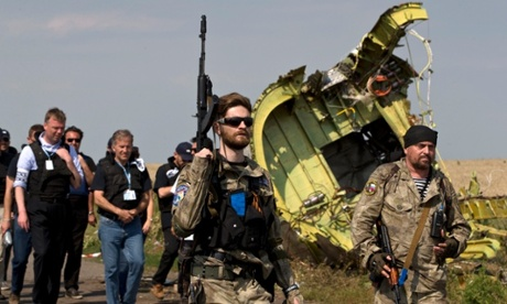 Pro-Russia rebels lead members of the OSCE mission at the site of the downed Malaysia Airlines flight MH17. Photograph: Vadim Ghirda/AP