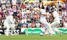 England's Alastair Cook is caught behind by MS Dhoni off Ravindra Jadeja for 95 off 231 balls.
