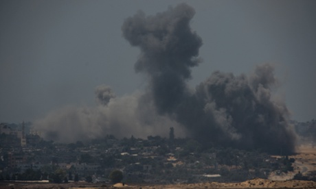 Smoke rises following Israeli airstrikes in northern Gaza on Sunday.