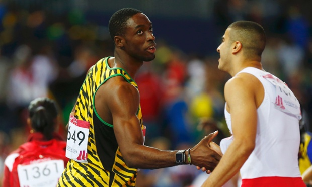 Gold medal winner Kemar Bailey-Cole of Jamaica shakes hands with silver medal winnier Adam Gemili of England
