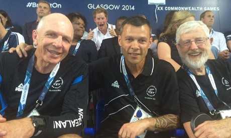 Prince Harry photobombs a picture with New Zealand sports officials.