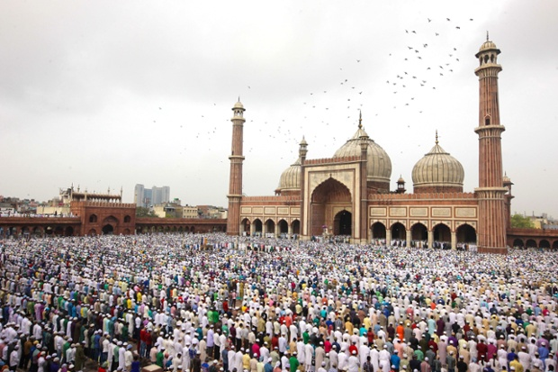 Indian Muslims attend prayers at the Jama Masjid in Delhi, India