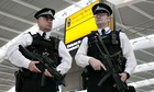British armed police patrol the new Terminal 5 at London Heathrow