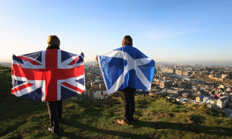 Union and Scottish flags held up over Edinburgh, Scotland.
