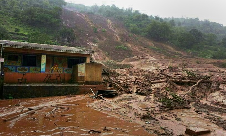 A mudslide surrounds a building in Malin