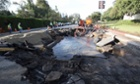 The site of a water main break is shown near UCLA in Los Angeles. A 93-year-old water main ruptured.