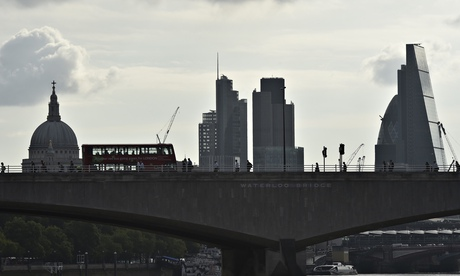 Workers cross Waterloo Bridge