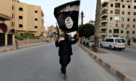 A Musim man waves the black flag of Islam in Iraq