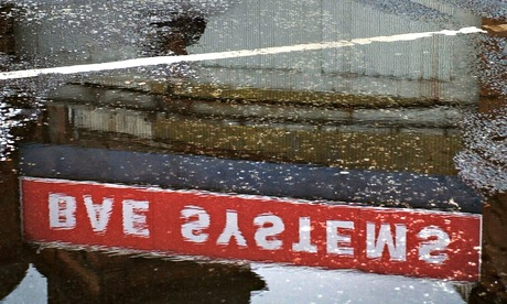 A BAE Systems sign reflected in a puddle