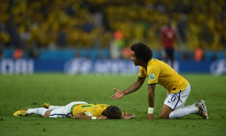 Brazil's defender Marcelo (R) gestures towards Brazil's forward Neymar who lies on the pitch after being injured during the quarter-final football match between Brazil and Colombia at the Castelao Stadium in Fortaleza during the 2014 FIFA World Cup on July 4, 2014.   AFP PHOTO / EITAN ABRAMOVICHEITAN ABRAMOVICH/AFP/Getty Images