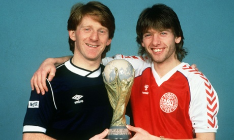 Gordon Strachan and Jesper Olsen with 'the World Cup' ahead of the 1986 finals. Classic Denmark strip not pictured, but then neither is the best Scotland one, so. (1982, since you ask.)