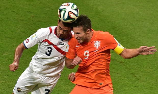 Costa Rica's defender Giancarlo Gonzalez vies with Holland forward and captain Robin van Persie.