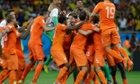 Holland players celebrate with the substitute goalkeeper Tim Krul after winning the penalty shootout against Costa Rica.
