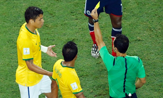 Brazil's Thiago Silva gets a yellow card during the World Cup quarterfinal soccer match between Brazil and Colombia at the Arena Castelao in Fortaleza, Brazil, Friday, July 4, 2014. (AP Photo/Fabrizio Bensch, pool) WSOC2014
