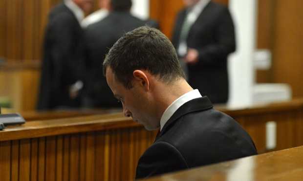 Oscar Pistorius sits in the dock in the high court in Pretoria.