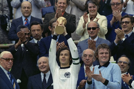 The West Germany captain, Franz Beckenbauer, holds up the World Cup trophy after his team defeated Holland 2-1 in the 1974 final in Munich.