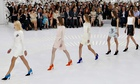 Models present creations for Christian Dior