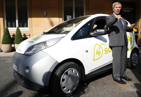 Vincent Bollore with one of his electric cars. Monthly membership in London will cost around £10, with a £5 fee per half hour's rental. Photograph: Reuters