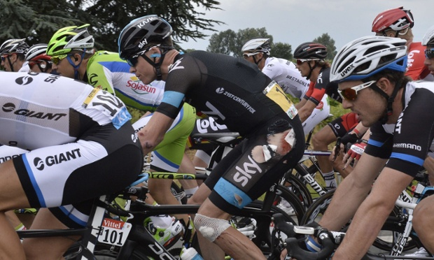 Chris Froome displays his battle scars on the road to Lille.