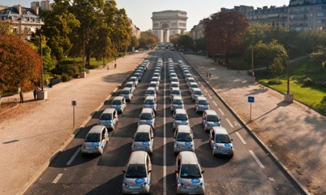 Autolib' electric cars in front of the Arc de Triomphe in Paris.