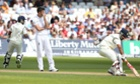 England's James Anderson looks on as India's Murali Vijay and Cheteshwar Pujara  do some running.