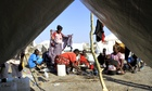South Sudanese refugees cook on an open