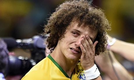 The emotion of defeat overcomes Brazil's David Luiz.