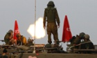Israeli soldiers stand on an armoured personnel carrier as they fire mortar shell towards Gaza before a ceasefire was due.