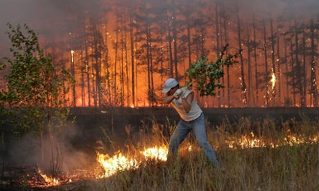 In 2010, heatwaves caused hundreds of wildfires across Russia. Above, a man tries to stop a fire near Dolginino village. Photograph: Artyom Korotayev/AFP/Getty Images